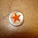 Small mother of pearl button with Vega Los Angeles star.