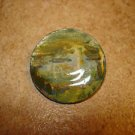 Large mother of pearl button with lighthouse scene.