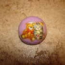 Dome shape plastic button with teddy bear and kitten.