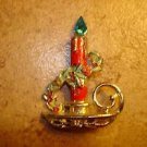 Metal Christmas candel with holder and rhinestone light brooch pin.