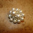 Vintage metal button with small and large pearls.