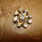 Old snowflake like metal button with Swarowski crystals.