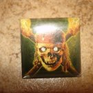 Large square metal button Pirates of Caribbean.