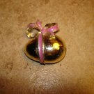 Metal Easter egg button with large bow.
