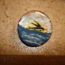 Old mother of pearl button with flying fish.