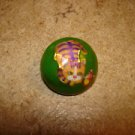 Old dome shape metal button with orange cat & butterfly.