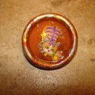 Wood button with orange cat and butterfly.