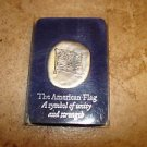The American flag a symbol of unity and strenght pewter plaque.
