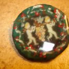 Paper mache button with cherubs signed by artist.