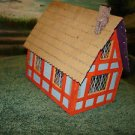O scale kit built Lionelville Tudor house offered by MTH.