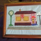 Framed embroidered artwork, pub scene
