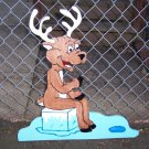 Handmade custom painted wooden reindeer sitting on the ice for your yard