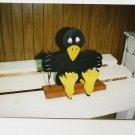 Handmade custom painted Crow on a swing