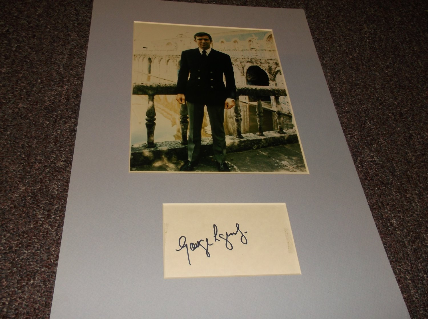 George Lazenby signed 3x5 card matted with photo