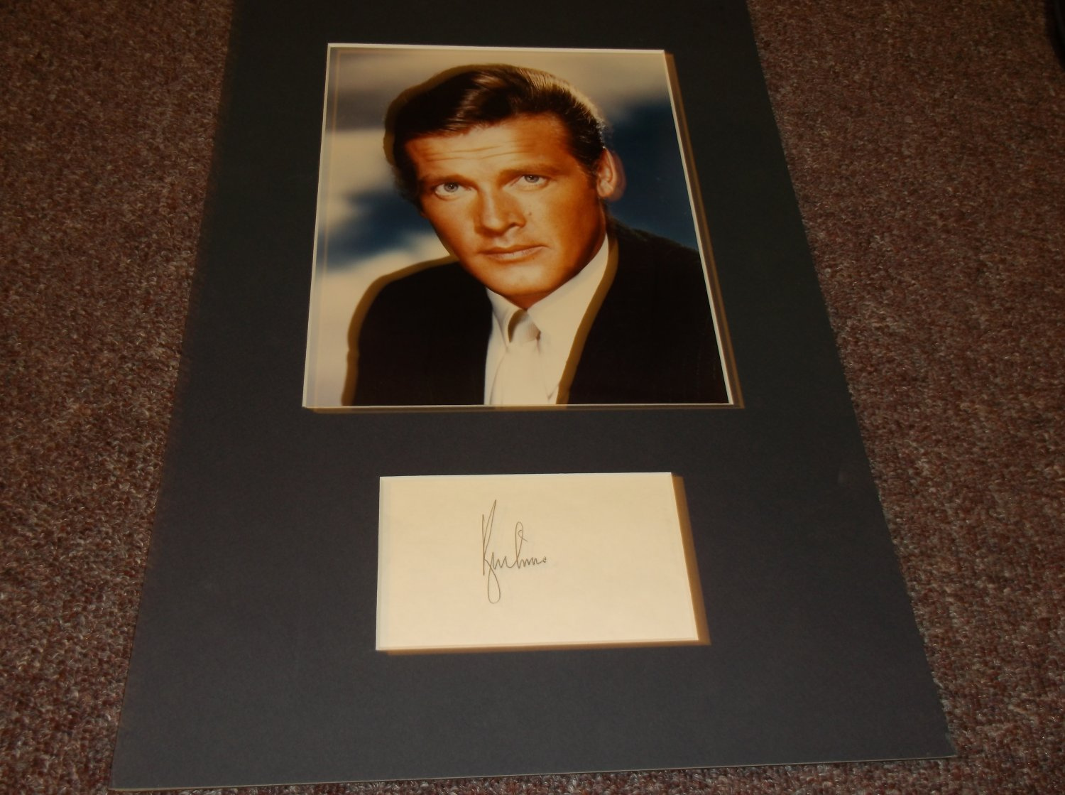 Roger Moore signed 3x5 card matted with photo