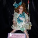 Dora is a  Pretty Porcelain Collectible Doll  From theCathay Collection