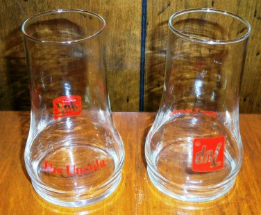 Two Vintage 7-UP The Uncola Upside Down Drinking Glasses