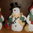 Three Snowman Figurines