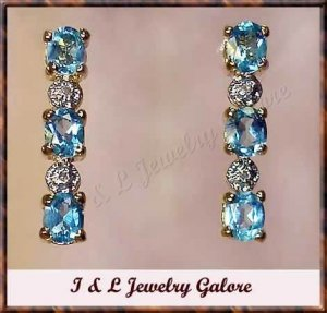 3.28 carat Blue Topaz & Diamond earrings
