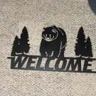 Welcome sign with bear and trees in a semi flat black finish