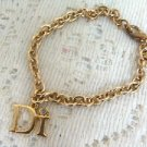 Di International  Charm Goldtone Bracelet