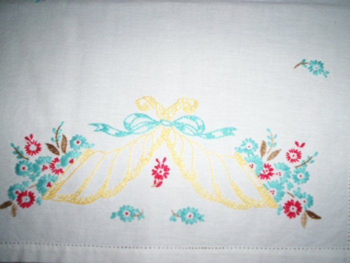 red and teal flowers in a yellow sconce dresser scarf table runner