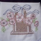 hand embroidered pillowcases cross stitch basket of red daisies and a blue ribbon