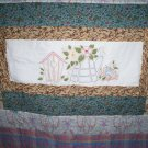 handmade baby quilt lap quilt hand embroidered garden in the spring 54 inches by 49 inches