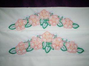set of 2 cream pillowcases orange poppies on a white trellises