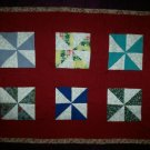 pinwheel doll quilt handmade 21 inches by 15 inches handcrafted rose binding