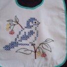 baby bib hand embroidered blue bird cross stitch wild flowers handmade