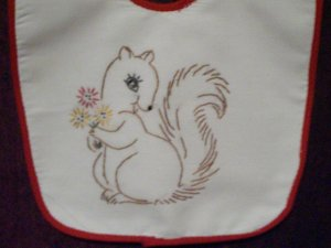 baby bib hand embroidered tan squirrel wild flowers handmade red binding