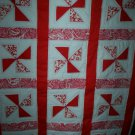 red pinwheel quilt handcrafted 39 inches by 50 inches handmade