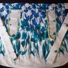 blue wild flowers on white apron