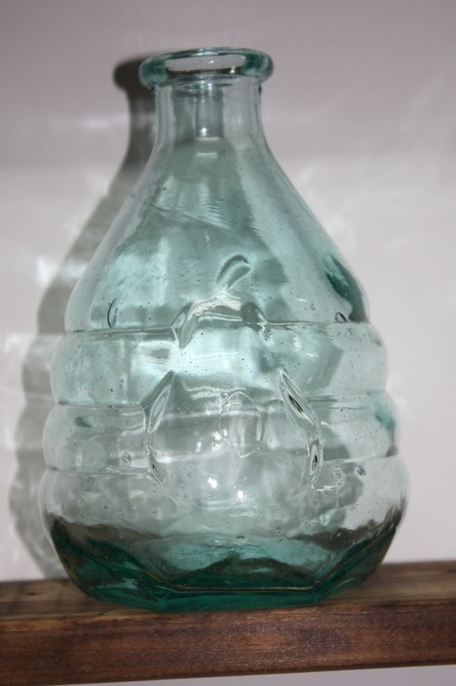 Vintage very interesting shape old bottle with a pear on for Interesting bottle shapes