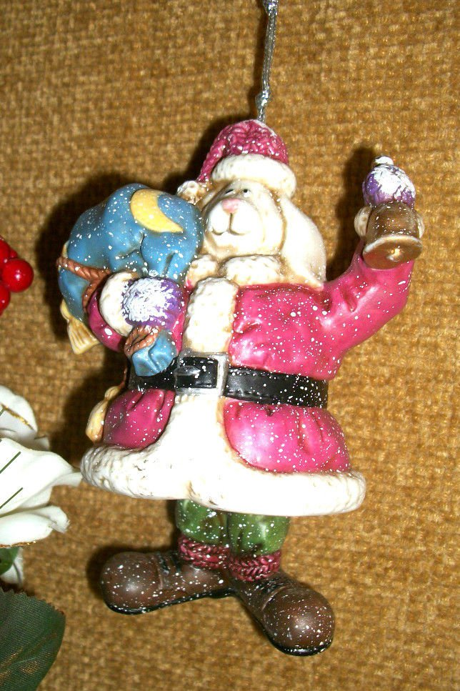 White Dog Dressed as Santa Claus with Toy Sack Ceramic Bell Christmas Ornament