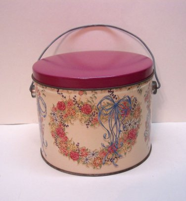 """Smart Little Tin with White Back Round and Hearts and Flowers. Size 5 3/8"""" x 6"""""""