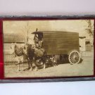 Antique picture of a moving van mounted on red glass panel, 7 x 4 1/4 inches