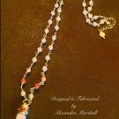 Bisque, Beige, and Terracotta gemstone and tusk pendant necklace $89