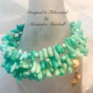Mint colored Coral Cuppolini memory wire wrap bracelet with gold leafed starfish charm $39
