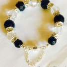 Faceted Black Onyx, Clear Crystal beads, and Set Crystal Sterling Silver Plated bracelet $59