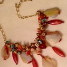 Orange and Yellow Agate Necklace Encrusted with Multi Colored Gemstone $189