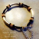Black Leather Bracelet with Silver & Gold Embellishments Bracelet $29