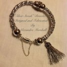 """Silver Streak"" Silver Braided Leather Crystal and Silver Tassel Bracelet $59"