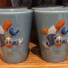 DISNEY PARKS DONALD DUCK THE FEATHERS ARE FLYIN SHOT GLASS NEW (SET OF 2)