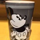 DISNEY PARKS BLACK AND WHITE CERAMIC SHOT GLASS THE MOUSE IS IN THE HOUSE NEW
