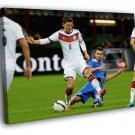 Mesut Ozil Sliding Tackle Germany Football 50x40 Framed Canvas Print