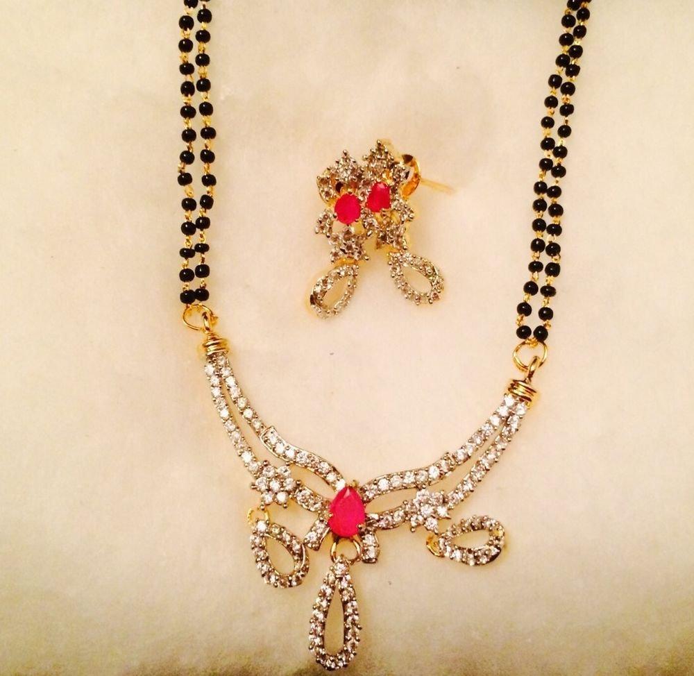 Diamond Mangalsutra With Beautiful Diamond Earrings
