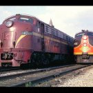 PRR #4268 & IC #4032 EMD E8s postcard diesel locomotives train railroad