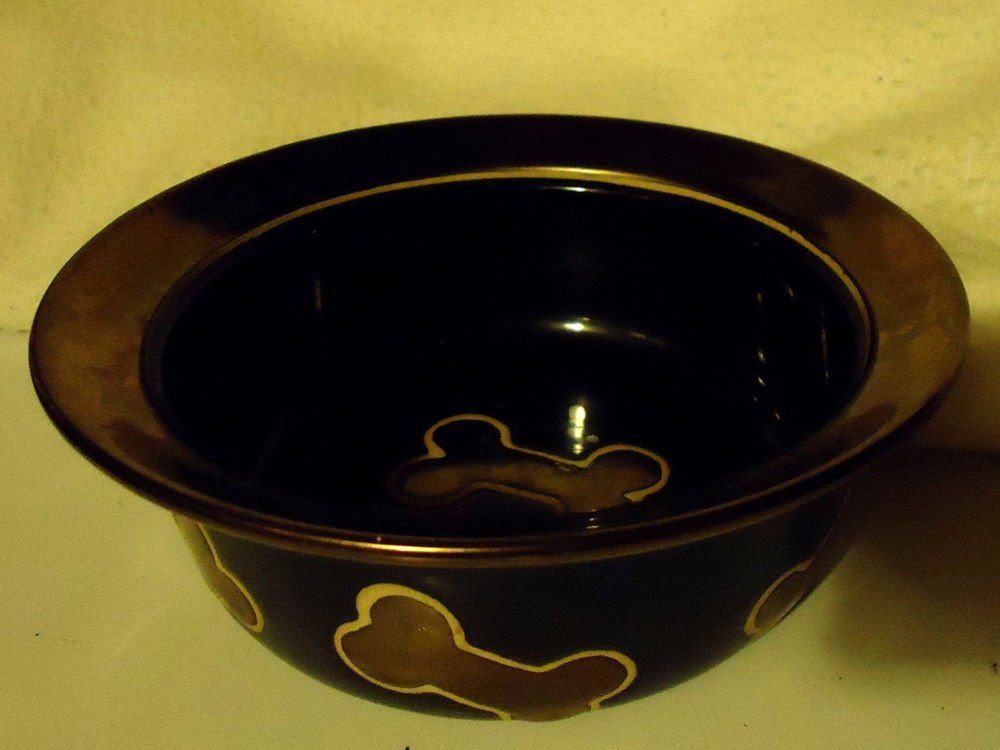 """CERAMIC DOG DISH FOR """"THE SPECIAL ONE""""...BLACK WITH  BONES....COPPER GOLD COLOR"""